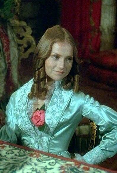 Мода 1840-х. Прическа с длинными локонами. Рукав платья, узкий на плечах, расширяется к локтям, потом снова сужается к манжетам.