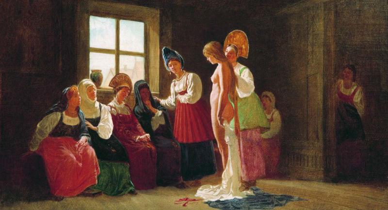 Невесте переплетают косу перед свадьбой