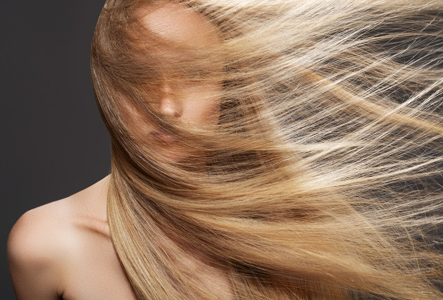 Wellness and spa. Sensual woman model with windswept flying dark blond hair